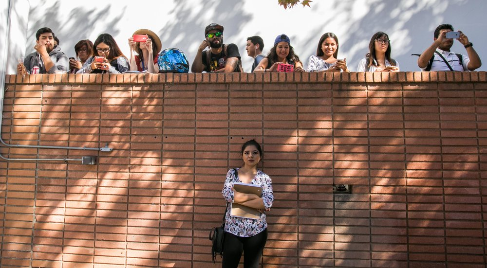 Students look on as their peers gathered outside of the library in protest of the presidential election results.