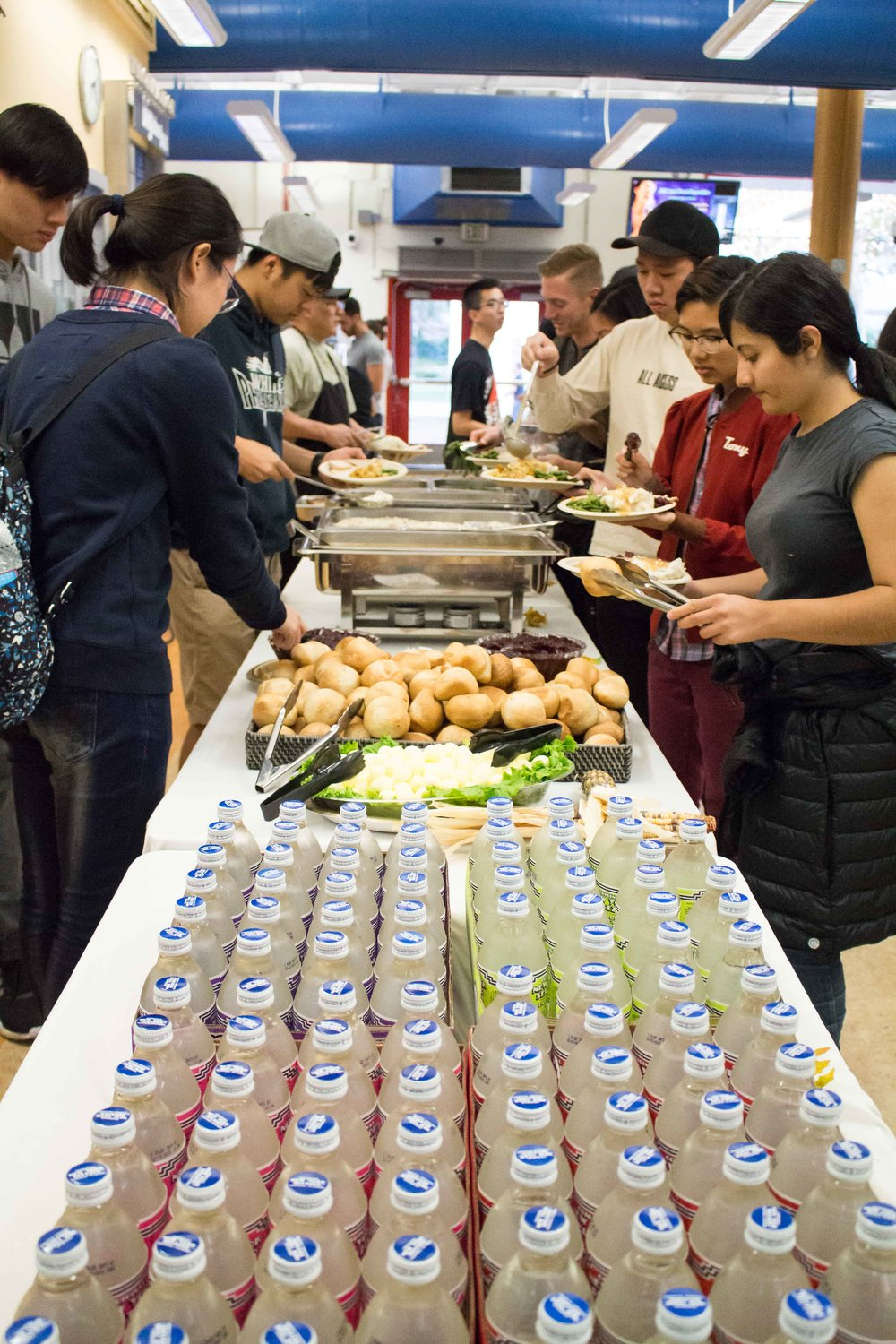 Santa Monica College students serve themselves their Thanksgiving meal provided by the Associated Students of Santa Monica and the Asian Culture Exchange Association at the Santa Monica College cafeteria in Santa Monica, CA on Nov. 22, 2016. (Marisa Vasquez)