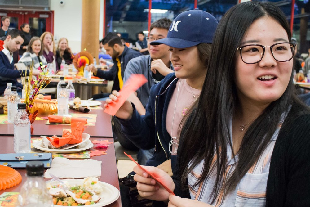 Santa Monia students receive yasui qian, a Chinese tradition which consists of a red envelope filled with money, during their Thanksgiving meal provided by the Associated Students of Santa Monica and the Asian Culture Exchange Association at the Santa Monica College cafeteria in Santa Monica, CA on Nov. 22, 2016. (Marisa Vasquez)