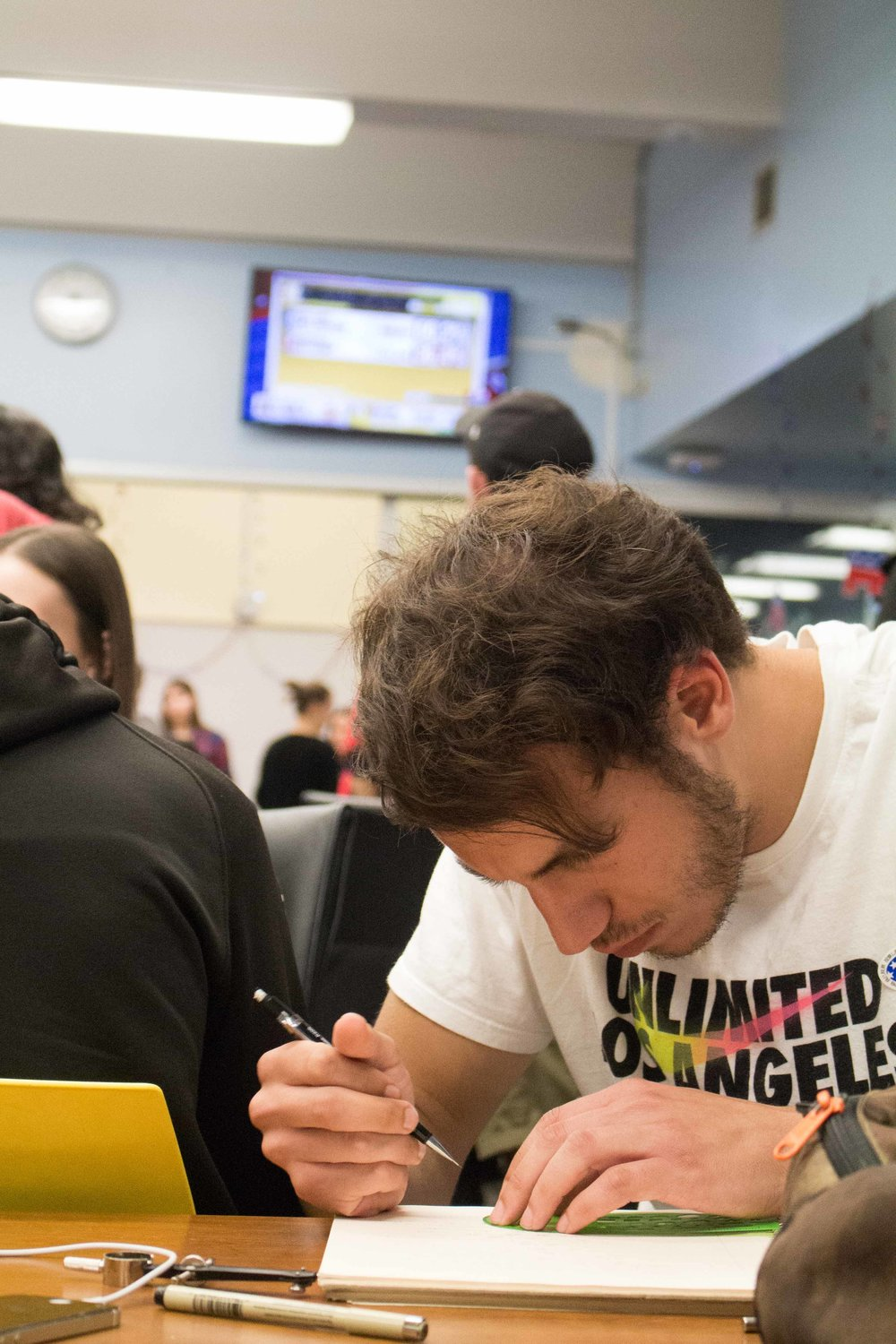 Sascha Martinelli studies astrophysics while watching the presidential election results at the 2016 presidential election result viewing party in the Cayton Center in the Santa Monica College campus in Santa Monica, Calif on Tuesday, Nov 9, 2016.