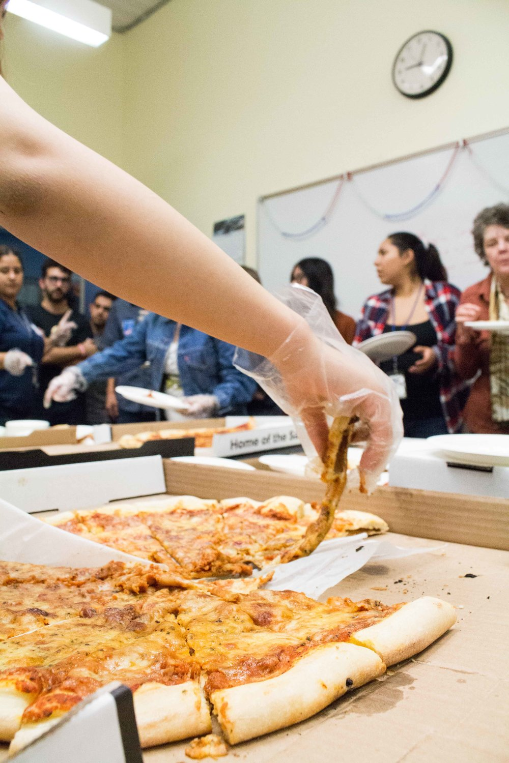 The Associated Students of Santa Monica serve pizza to fellow Santa Monica Students during the 2016 presidential election result viewing party in the Cayton Center in the Santa Monica College campus in Santa Monica, Calif on Tuesday, Nov 9, 2016.