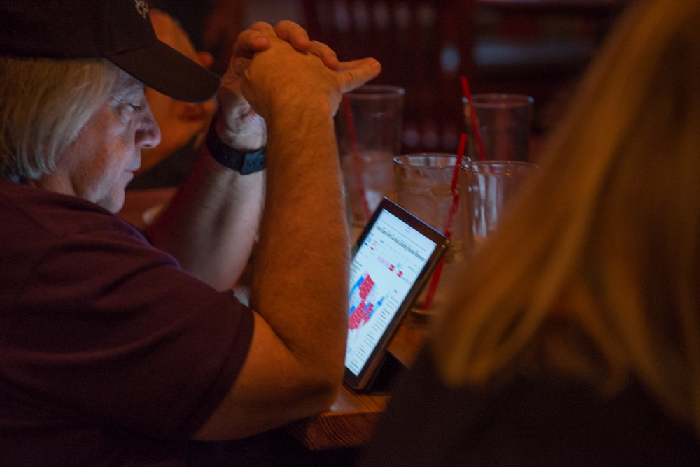 Craig Deman reacts to the outcomes from the presidential  electoral vote from his iPad during the presidential viewing at the Typhoon Restaurant in Santa Monica, Calif on Tuesday, November 8, 2016. (Rosangelica Vizcarra)