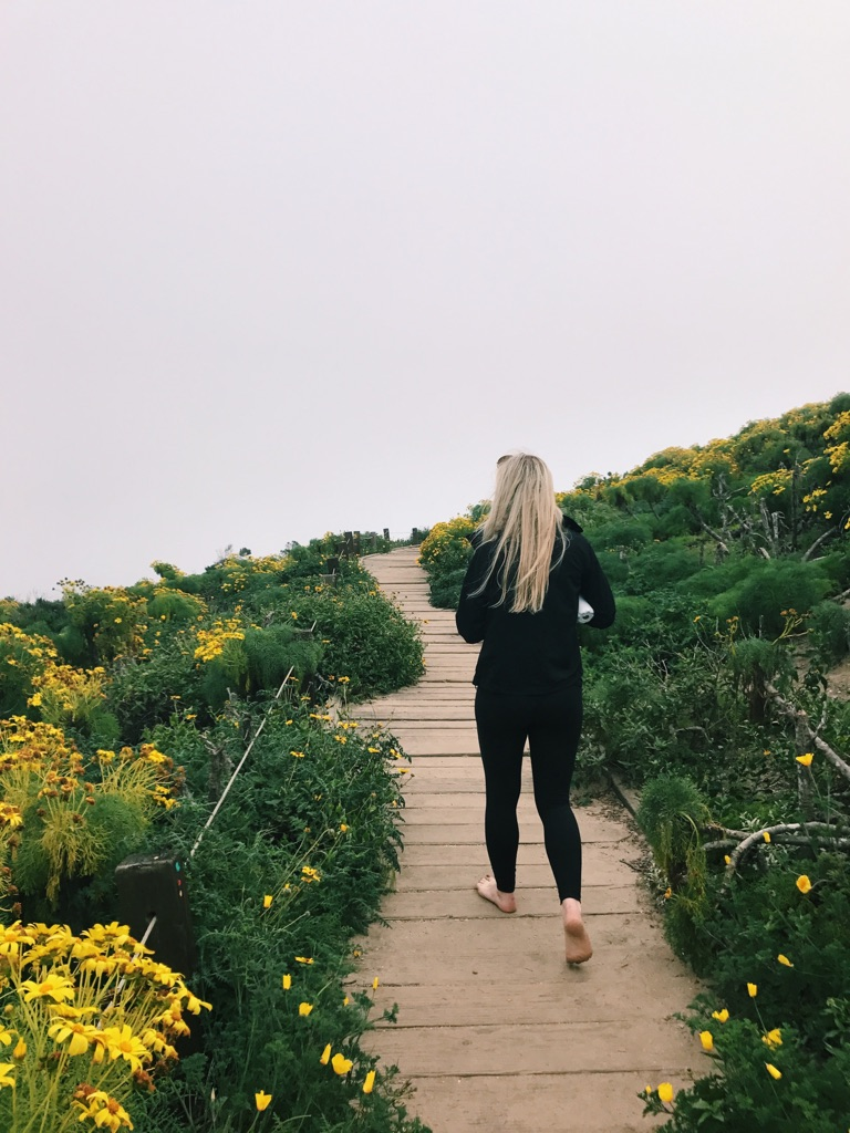 Lily Giedd, 20, saunters down the main trail at Point Dume, Malibu.