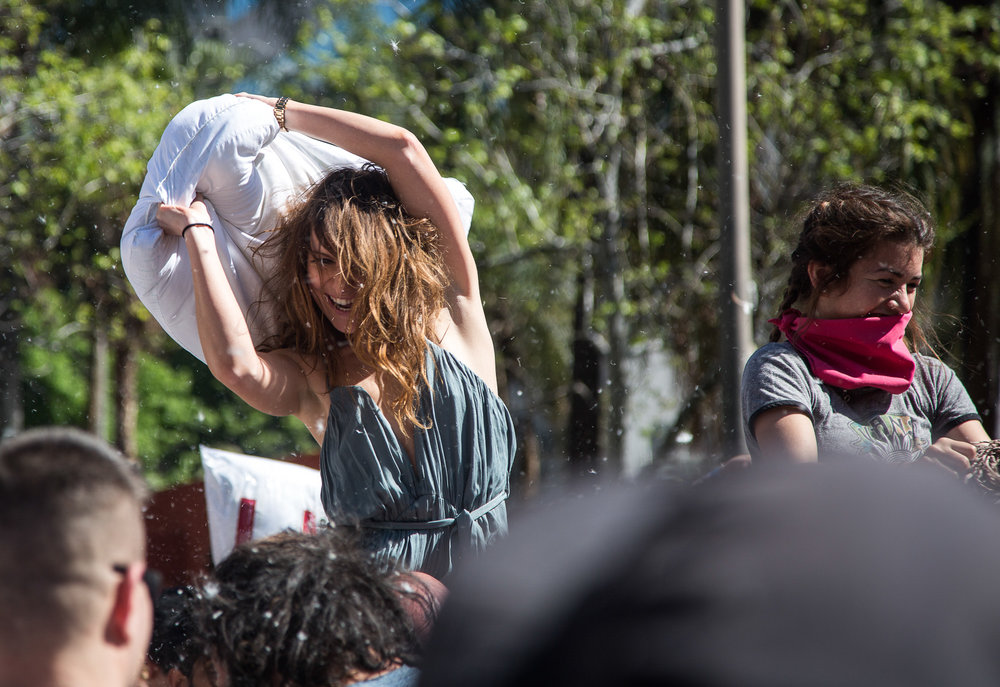 LA local and pillow fight enthusiast Daria Ritch nails powerful pillow strikes against her opponents as she sits on her boyfriends' shoulders during the National Pillow Fight Day event which took place in Pershing Square in Downtown Los Angles Calif., on Saturday, April 1, 2017. Hundreds of people traded soft blows in a giant pillow fight that dwarfed even the biggest slumber party slugfest. The annual event is held to celebrate International Pillow Fight Day as children, teens, adults and seniors swung pillows at one another for over 2 hours during Saturdays event. (Corsair Photo: Matthew Martin)