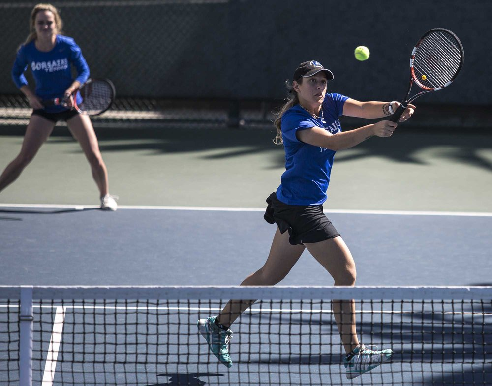 Santa Monica College Corsair sophomore Mayra Jovic (#1, right) hits a high forehand while Santa Monica College Corsair freshman Abby Mullins (#2, left) waits defensively behind her during their 1–0 (8–1) doubles set victory which was part of the Corsairs 7–1 victory over the Ventura College Pirates at the Ocean View Park Tennis Courts in Santa Monica California, on Thursday, March 23 2017. (Corsair Photo: Matthew Martin)