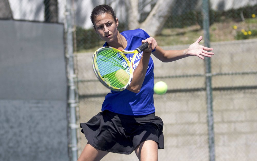 Santa Monica College Corsairs freshman #4 singles Srna Lepchevska approaches a short forehand in her 2-0 (6-1, 6-1) victory, as the Corsairs cruised by Ventura College with a 7-1 win at Ocean View Park in Santa Monica California on March 23, 2017 (Photo By: Zane Meyer)