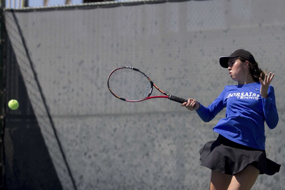 Santa Monica College Corsairs freshman #5 singles Irene Feher powers through a forehand on the way to her 2-0 (6-2, 6-0) match win which helped the Corsairs score a 7-1 victory over Ventura College  at Ocean View Park in Santa Monica California on March 23, 2017 (Photo By: Zane Meyer)
