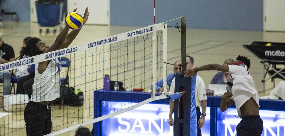 Santa Monica College Corsair freshman outside hitter Dane Pieper (17, left) successfully blocks the spike by Pierce College Brahmas freshman setter/opposite hitter Mario Patrick (4, right) in the Santa Monica College gymnasium in Santa Monica Calif., on Wednesday March 1 2017. The Corsairs were able to sweep the Brahmas 3-0 by the end of the game. (Corsair Photo: Matthew Martin)