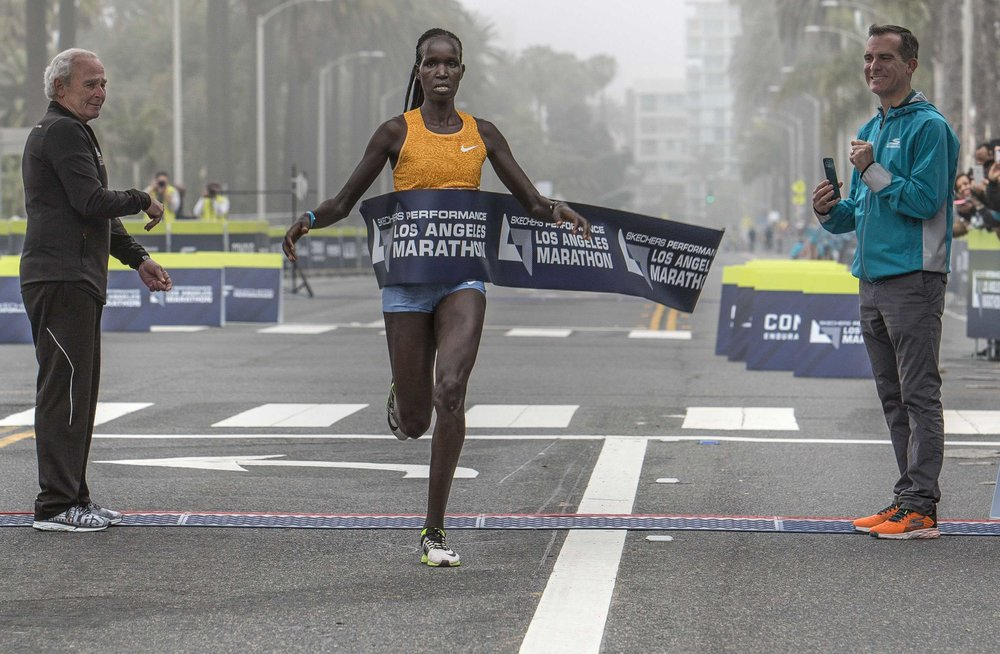 March 19, 2017. Hellen Jepkurgat from Kenya won first place in the women's division in The Los Angeles Marathon that finished in Santa Monica California. Jepkurgat finished in a time of two hours thirthy four minutes and twenty three seconds according to the official L.A. Marathon tracker. Santa Monica, California. Photo By: Daniel Bowyer / Corsair News