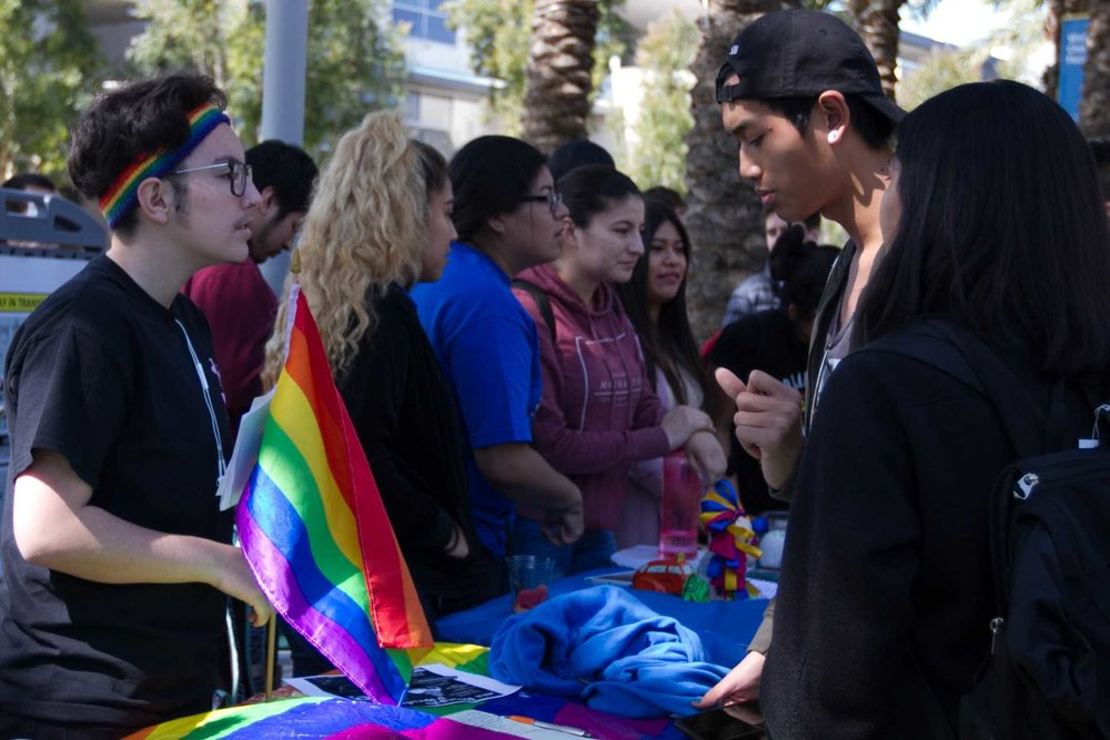 Mysterie Peña (left), president of the GSA talks to Tommy Pathammavong (right) about what he can expect upon joining the club at Club Awareness Day at Santa Monica College in Santa Monica California on March 14, 2017 (Photo By: Zane Meyer)