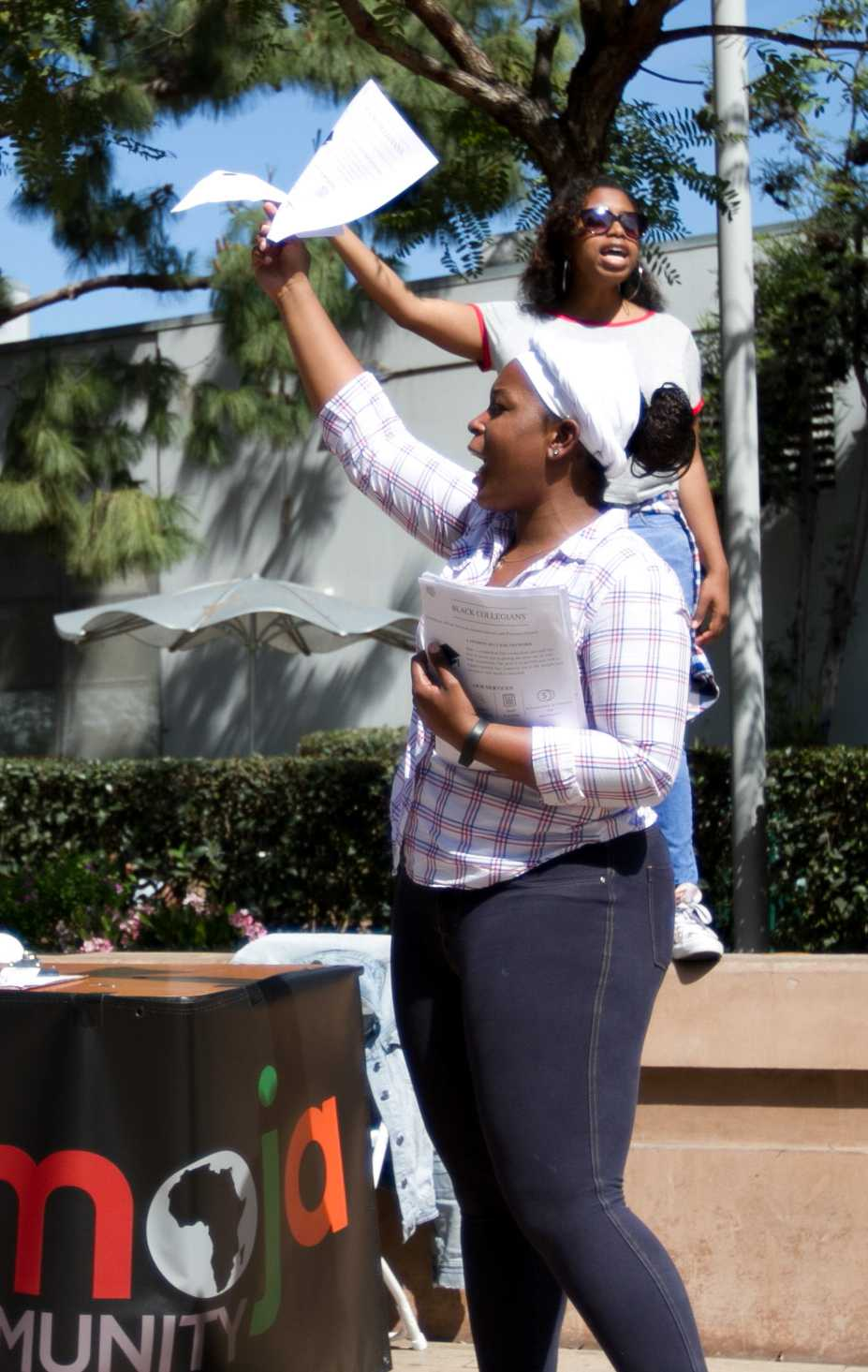 Black Collegians activity director Jessica Mebane (front), and Vice President Monique Muepo (back) recruit new members and spread awareness for their organization at Club Awareness Day at Santa Monica College in Santa Monica California on March 14, 2017. (Photo By: Zane Meyer)