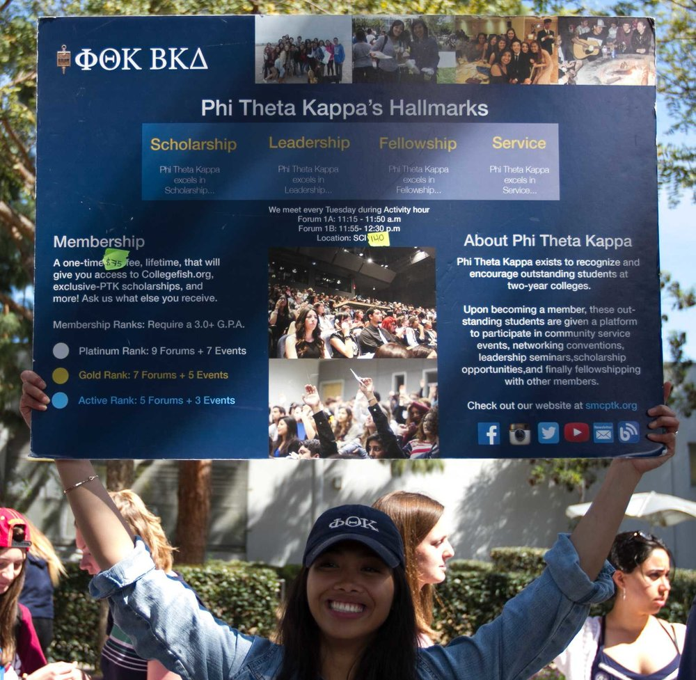 Representative of the Phi Theta Kappa, Maggie Mumar (center) informs fellow students of what opportunites they can take advantage of by joining Phi Theta Kappa at Club Awareness Day at Santa Monica College in Santa Monica California on March 14, 2017 (Photo By: Zane Meyer)