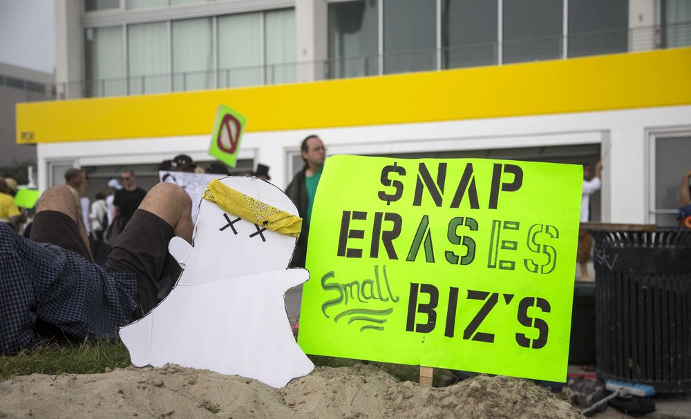 Protestors called The Alliance for the Preservation of Venice asks you to boycott SNAP Inc. and Snapchat in front of Snaps newly opened storefront, Spectacles at 701 Ocean Front Walk, Venice, Calif., on Saturday March 11 2017. Their argument is that the Venice boardwalk, an eclectic beach neighborhood unique to LA, has been deadened by Snapchat, which has occupied Venice shops and residences to the detriment of neighbors. Many of the longtime residents are not rich, and have seen their rents double and triple as Snap moved in and expanded. (Corsair Photo: Matthew Martin)