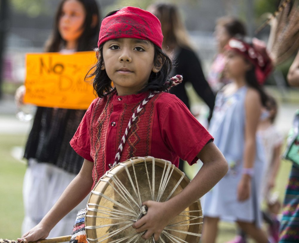 "A young activist and ""water protector"" is photographed arriving at Los Angles City Hall after marching with a coalition of activists and water protectors during the Divest LA march in downtown Los Angles, Calif., on Friday, March 10 2017. (Corsair Photo: Matthew Martin)"