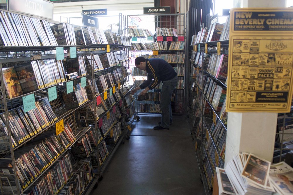 Employee Robbie Mccluskey files old movies one morning before doors open to the public at Vidiots, the 31 year old movie rental store located at 302 Pico Blvd, Santa Monica, CA 90405 on November 29, 2016. The unique store had trouble in recent years trying to find funding to keep its doors open. At this time the store was open after a crowd funding service and donations gave it new life. Unfortunately, the store has now closed its Pico location doors for good and will hopefully reopen in a new Los Angeles location by 2018. Photo by Cecilia Martin