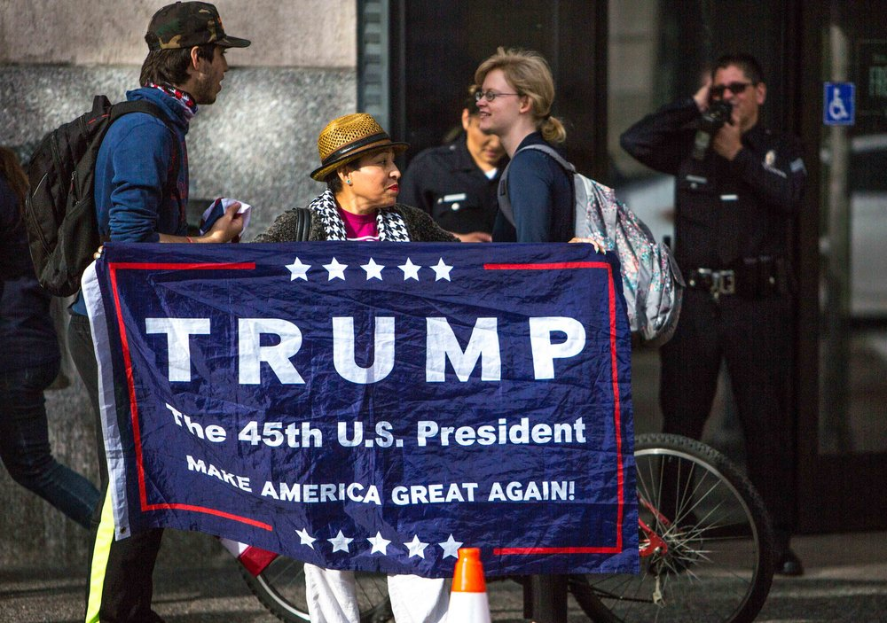 Elsa Aldeguer an avid Trump supporter from Los Angeles stood across from protestors against the airstrikes in Syria ordered by US President Donald Trump in Los Angees, California, April 8, 2017. Daniel Bowyer