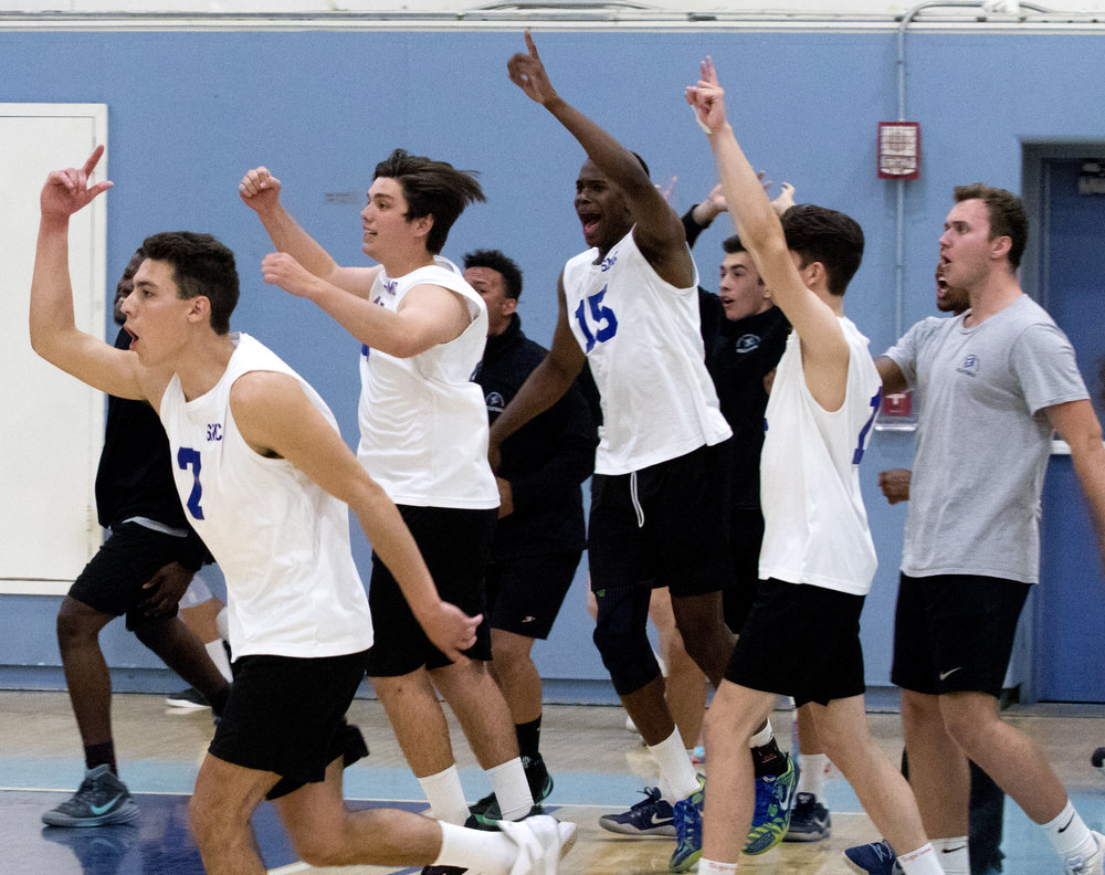 The Santa Monica College Corsairs bench rushes the court in celebration as the Corsairs win the match 3-2 against Pierce College Brahmas on April 21, 2017 at the Santa Monica Gymnasium at Santa Monica College in Santa Monica California (Photo By: Zane Meyer-Thornton)
