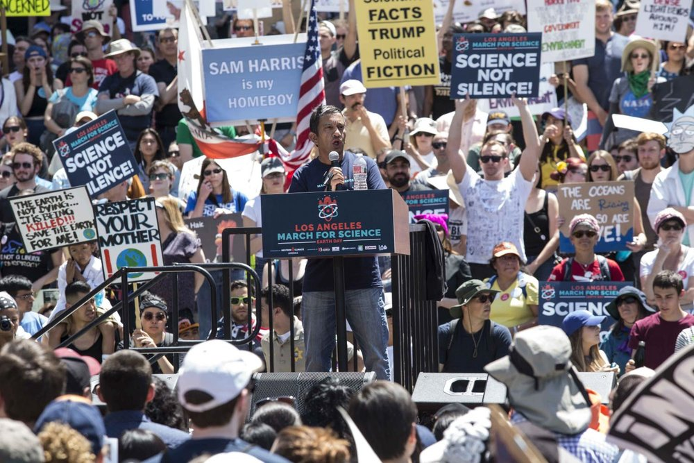 Nitin Apte, Chief Executive Officer and President at Materia Inc. speaks to the thousands of March for Science protesters in attendance in front of Los Angles City Hall about the importance of billionaires like him getting involved with the issues of climate and safeguarding the important role scientists play in government and politics in downtown Los Angles California, on Saturday, April 22 2017. Matthew Martin.