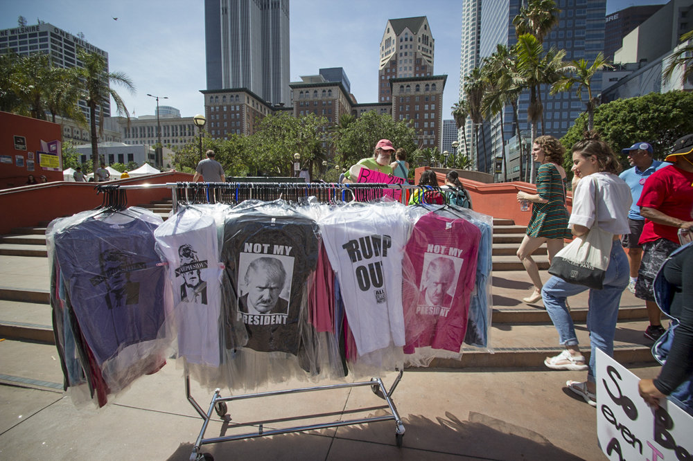 Somone's unattended clothing rack of anti-trump shirts at the March for Science rally on Earth Day in Downtown Los Angeles, April 22, 2017. (Jazz Shademan)