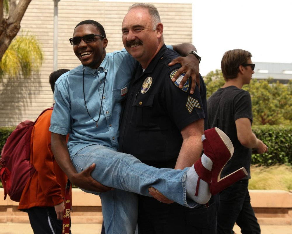 President Terrence Ware Jr. and Sgt. Romano pose for a picture during Consent week at Santa Monica College on April 26th, 2017. Jose Aguila.