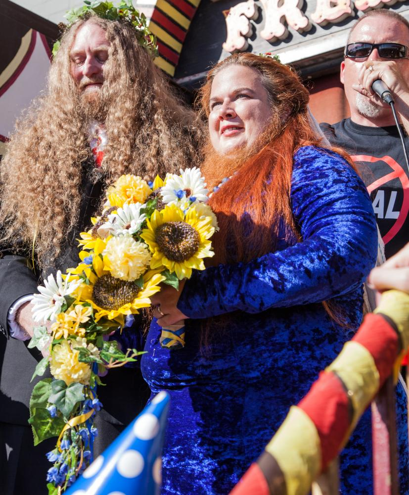 Craig Burlingame, left, and Jessa The Bearded Lady, center, face the crowd after getting married on the front steps of The Venice Beach Freakshow, by Todd Ray, right, owner of the Freakshow on Sunday, April 30, 2017 in the Venice Neighborhood of Los Angeles, Calif. The Venice Beach Freakshow held the wedding as part of its last event, a Farewell Party and Protest, as it closes its doors for the last time.Alfonso Castaneda Jr.