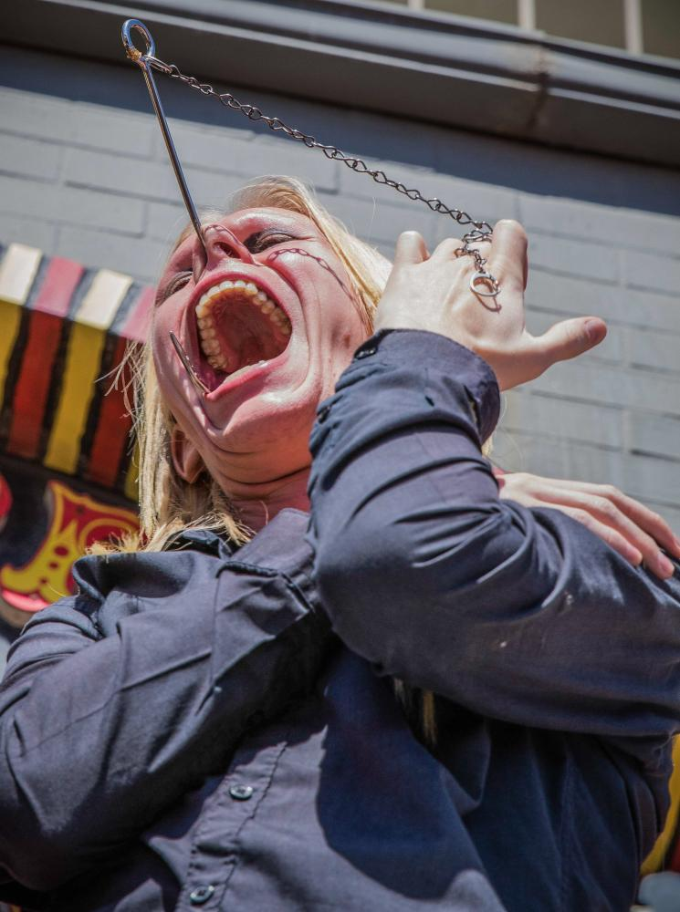 Venice Freakshow performer Morgue performs a mind bending feat in which he shoves a meat hook through his nose and out of his mouth without any harm being done for himself at the Venice Beach Freakshow Farewell Party and Protest in Venice California on April 30, 2017. Zane Meyer-Thornton.