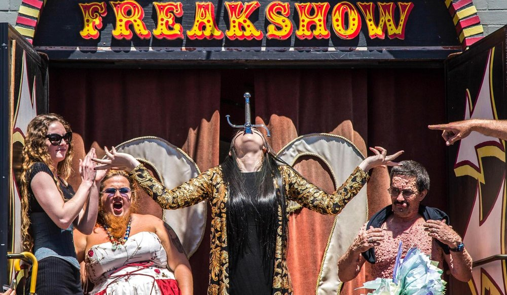 "Venice Freakshow performer Asia Ray, resident Sword swallower and fire-eater, shows off her skill of sword swallowing during the Venice Freakshow Farwell Protest and Party on the Venice Boardwalk in Venice, Calif., on Sunday, April 30 2017. Ray has been with the freak show since her father Todd Ray opened this house of wonders in 2006 and ""made the most of [her] final performance for the Venice Freakshow enthusiasts."" Matthew Martin."