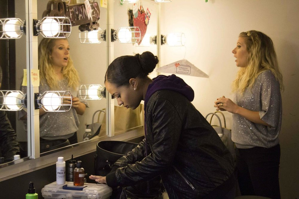 Backstage, minutes before the show, Ashlyn Smith (left) puts on a last touch of make up while Rebecca Mantei warms up her voice. Voices of Hope, play by Pamela Lassiter Cathey about sexual assault and its consequences for the victims. On Studio Stage Productions/Performances at Santa Monica College, Calif. On Friday April 28, 2017. (Emeline Moquillon)