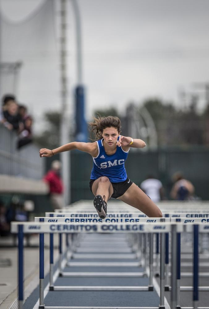 Santa Monica College Corsair sophomore athlete Michaela Cosentino competes in the Women's 100 meter hurdels event during the So Cal track and field semi-finals and wins 7th place in the Cerritos College field in Norwalk, California, on Saturday, May 6, 2017. (Daniel Bowyer)