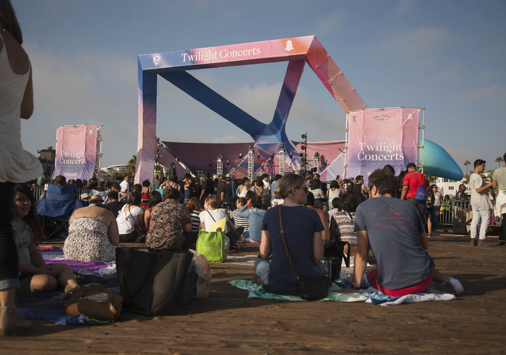 The crowd at Santa Monica Pier's Twilight Concert Seriers shows up early to get a space to watch the weekly concerts on summer Thursdays. (Adriana Delgado)