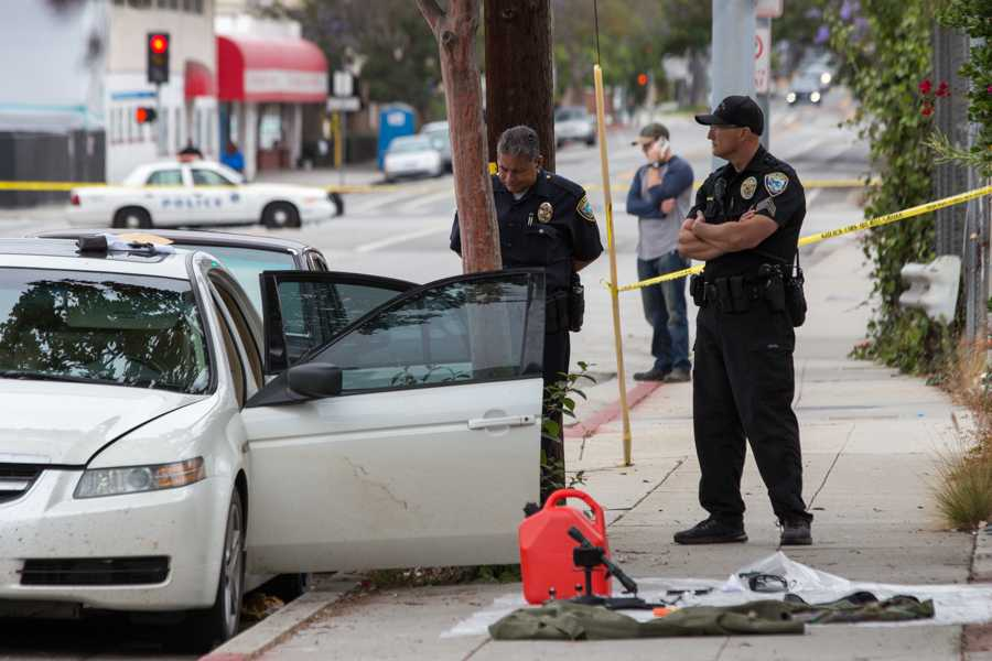 Santa Monica Police investigate a car where weapons and ammunition were found in the vehicle of James Wesley Howell on 11th Street just off of Michigan Ave. on Sunday, June 12, 2016 in Santa Monica, Calif. Howell is now in custody and is believed to have had plans to target today's Los Angeles Gay Pride event in West Hollywood with violent intentions. (Jose Lopez)