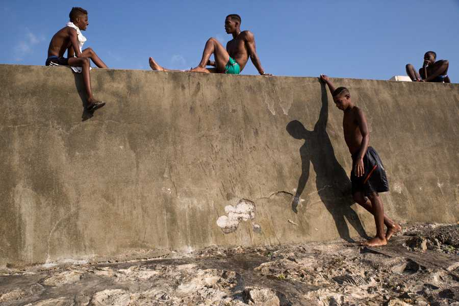Cuban youth gather along the Malecon after swimming in the ocean in Havana, Cuba. Jose Lopez