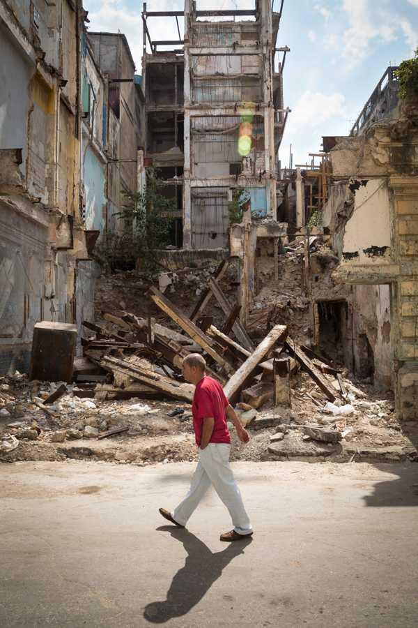 A man walks by a collapsed building in Havana, Cuba. Jose Lopez