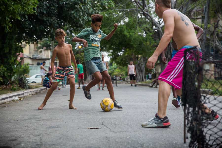 Youth play a game of soccer on the streets of Havana, Cuba. While baseball is the popularized sport of Cuba it is soccer that was the sport more often found throughout the streets. Jose Lopez