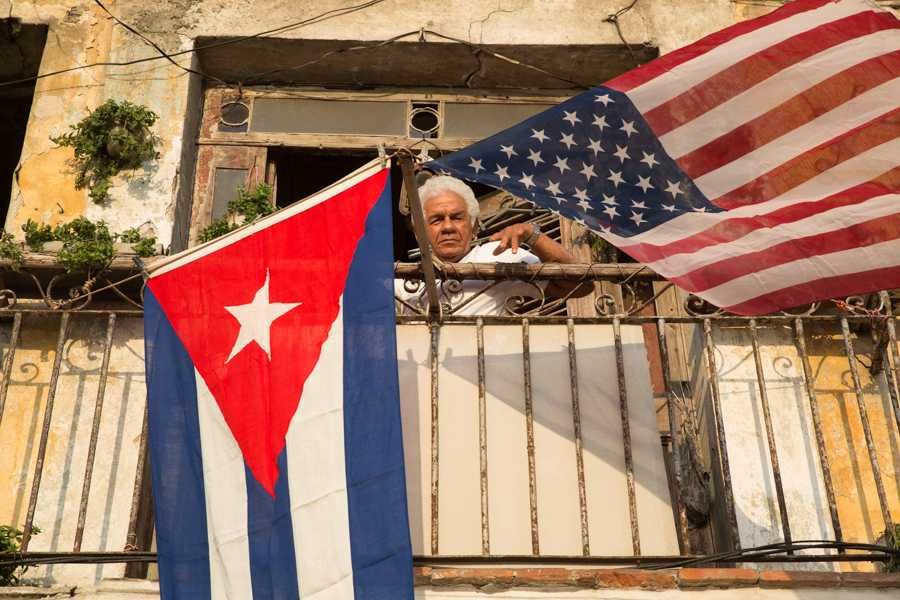 Luis Yanez Aguilar, 72, hangs the Cuban and American flag to greet the first American cruise ship arriving in Havana, Cuba in almost 40 years. Jose Lopez