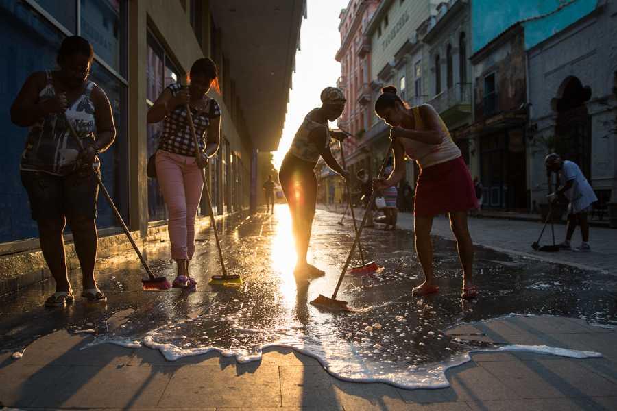 A crew of women scrub clean a street in Havana, Cuba. Jose Lopez