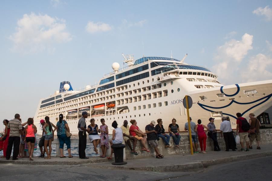 Cubans line up to take pictures of and view the cruiseship Adonis, run by Fathom Travel, docked in Havana, Cuba on May 2, 2016. This is the first cruiseship to make its way to Cuba since 1978 carrying a total of 704 passengers from Miami. (Jose Lopez)