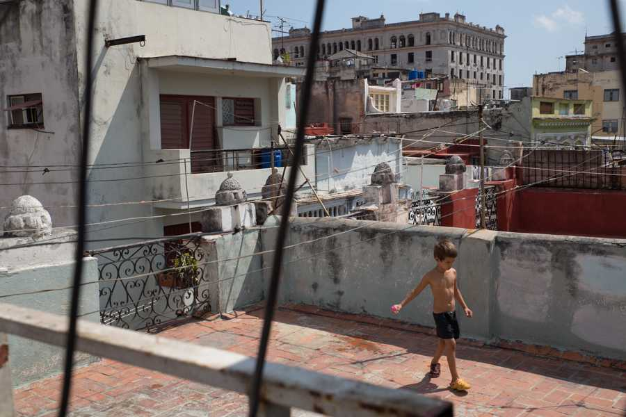A boy plays on the rooftop of a building in Havana, Cuba. Jose Lopez
