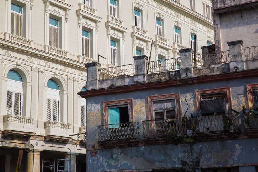 A colonial building that is almost completely restored can be seen behind an old building still in decay in Havana, Cuba. Jose Lopez