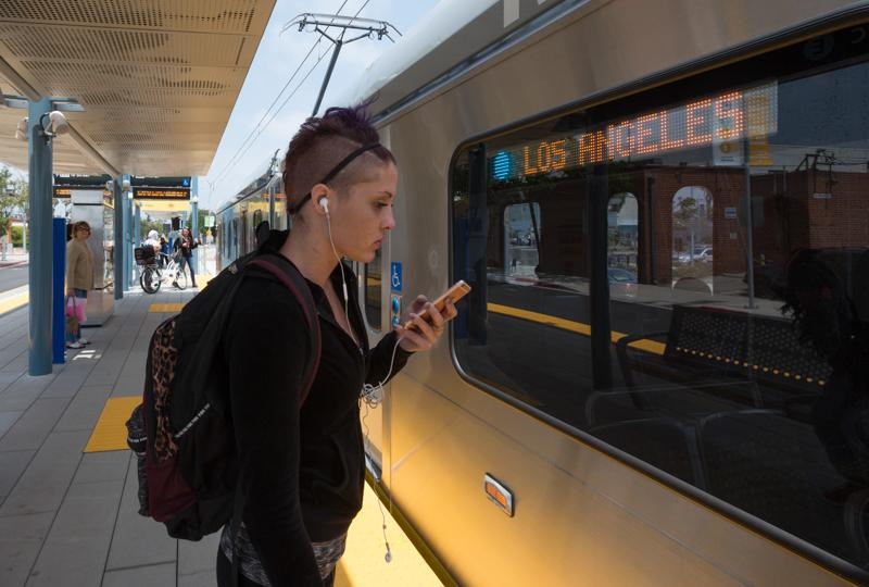 Jennifer Bryan, 19, a cosmetology student waits for the expo line train at the SMC stop on Tuesday May 31, 2016. Jennifer is one of the many students who use the train to commute to school. Josue Martinez