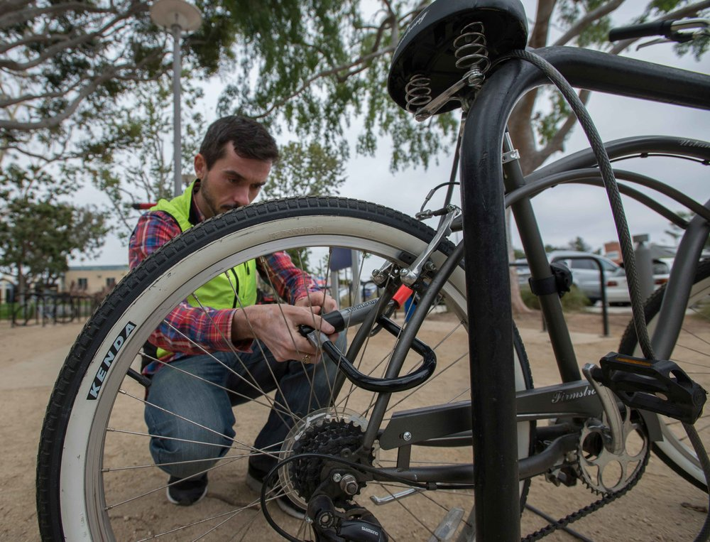 Physical and Forensic Anthropology professor Ciaran Brewster unlocks his bike near the bike lot on Pearl Street on Monday, May 31, 2016. (Josue Martinez)