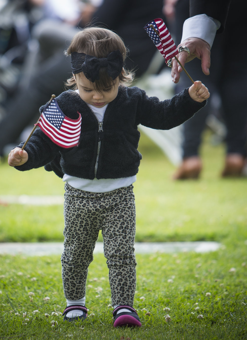 May 29,2017. 2 year old Ziva Ramiez attends the 79th Annual Memorial Day Observance at Woodlawn Cemetary in Santa Monica California, with her father Brandon Ramiez. Bradon a member of The Masonic Mens lodge, in Santa Monica presented a wreath to the tomb of the unknown solider. (Daniel Bowyer)