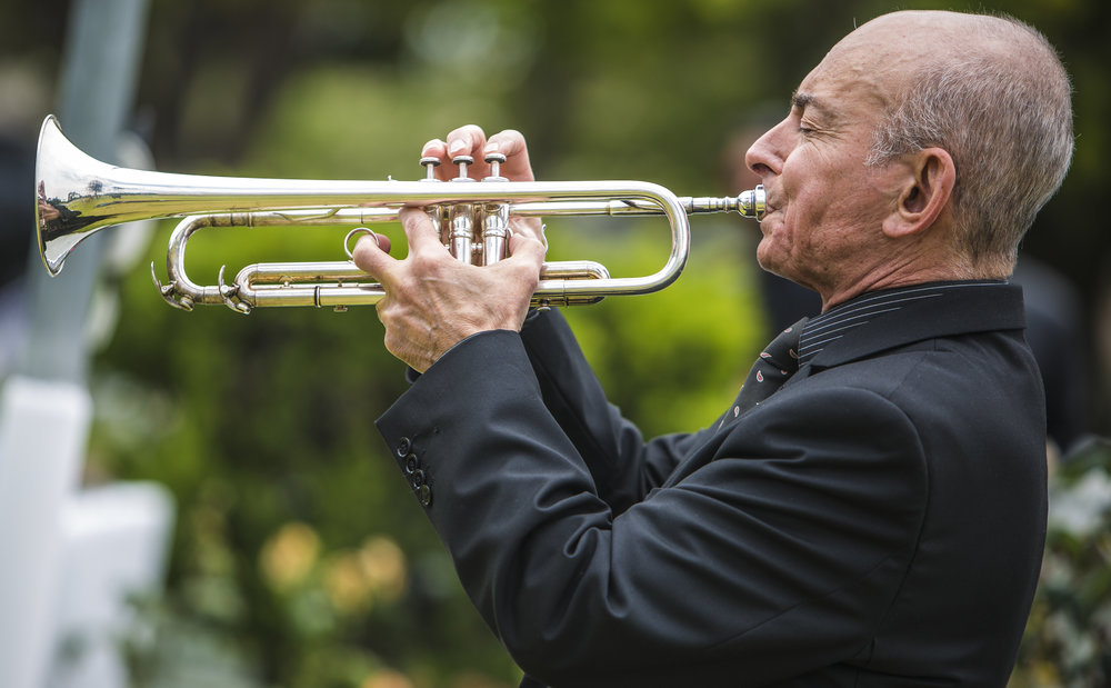 May 29,2017. Paul Salvo pricipal trumpet player for the Santa Monica Symphony play Taps at the 79th Annual Memorial Day Observance at Woodlawn Cemetary in Santa Monica California. (Daniel Bowyer)