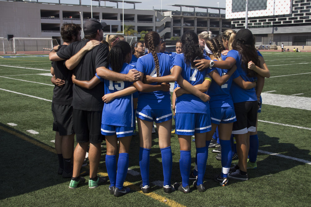 The Santa Monica Corsairs Women's soccer team huddling before their match against the Long Beach City Collge Vikings on Tuesday, August 29th, 2017 at the Santa Monica College Field at Santa Monica, California. They came out with a draw 1-1 after having two goals disallow due to offsides. (Photo by Brian Quiroz)