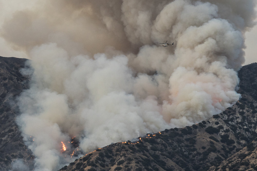 La Tuna Fire continues to burn throughout the Labor Day weekend in Burbank, Ca on September 2, 2017. The wildfire started due to the heatwave and winds in Los Angeles. Helicopters constantly patrol the areas. (Jazz Shademan)