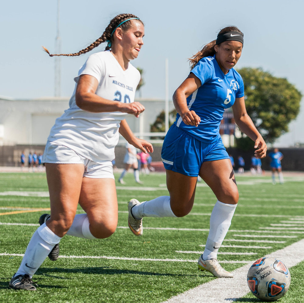 Joscelyn Diaz (5, middle-right) of the Santa Monica College Women's Soccer Team chases down a loose ball against Alexandria Steward (20) of MiraCosta College. The Corsairs Women's Team won the game 1-0 against the MiraCosta Spartans. The match was held at the Corsair Field at Santa Monica College in Santa Monica, Calif.. September 6, 2017. (Photo by: Justin Han/Corsair Staff)
