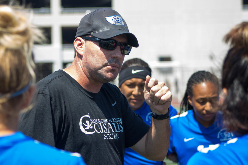 Coach Aaron Benditson giving his team a pep talk before their soccer game at Santa Monica College Field in Santa Monica, California against the MiraCosta Spartans on Wednesday, September 6th, 2017. The Corsair went on to win the game 1-0. (Photo by: Brian Quiroz)