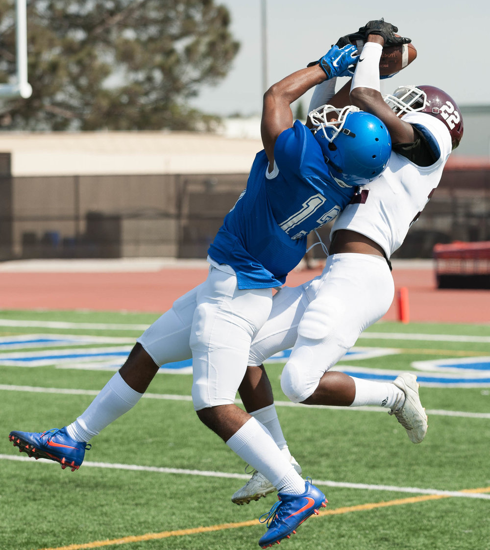 Wide receiver Elijah Boykin (13) of the Santa Monica College makes a contested catch against defensive back Nathaniel Ferguson (22) of Mt. San Antonio College. The Corsairs fell short 6-41 to the Mt. San Antonio Mounties, losing their second game in a row. The game was held at the Corsair Stadium at the Santa Monica College Main Campus in Santa Monica, Calif.. (Justin Han)