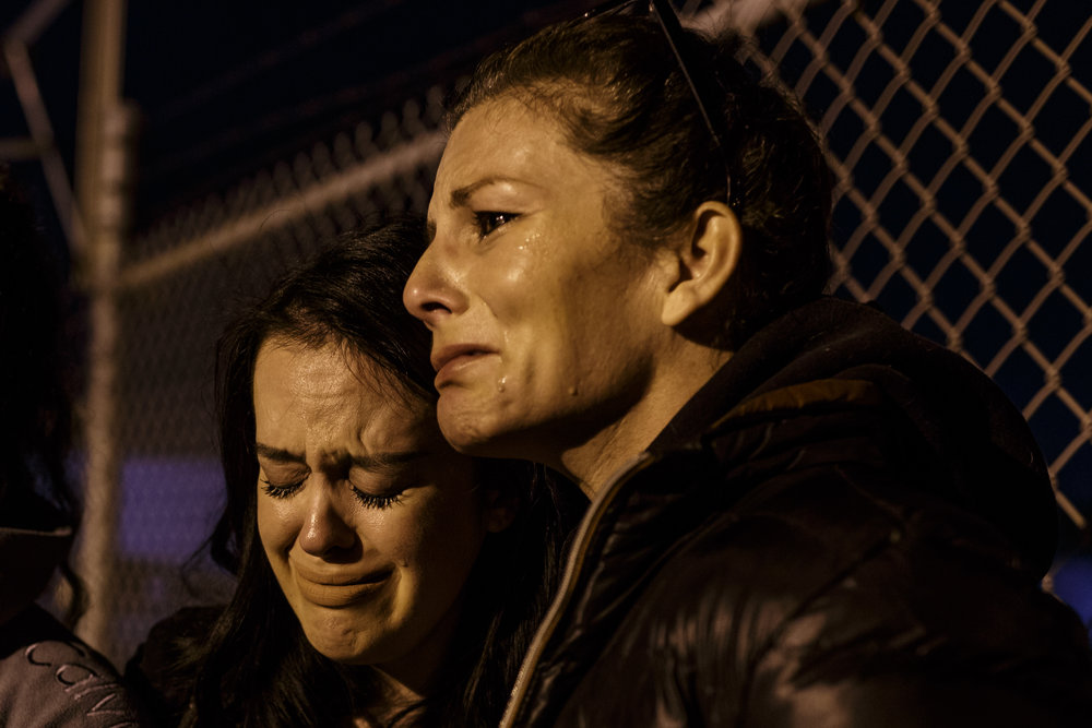 Jo McGuinness comforts Michelle Hill at a vigil for pigs held outside Farmer John, a slaughterhouse in Vernon, CA. Michelle recently became vegan and reconnected with Jo over social media - this is her first time at a vigil. March 22nd 2017 photo by Ruth Iorio