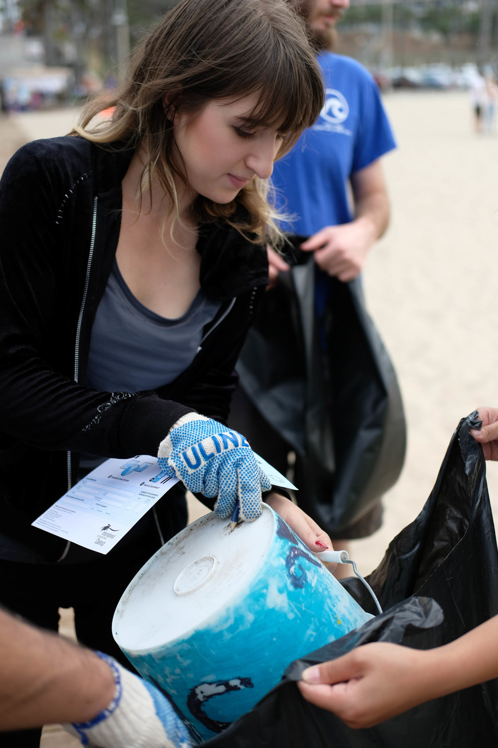Maria Volkova, a student at Santa Monica College, dumps her Heal the Bay trash bucket in Santa Monica, CALIF on September 16th, 2017.